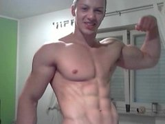 Muscle Flexing by a hot young Muscle Stud