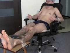 Guy tied to chair