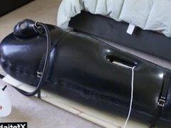Girl enjoys vibrator and rubber encasement