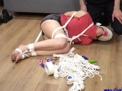 Hogtied and blindfolded