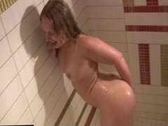 Blondie fingers her pussy in the shower