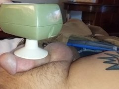 using a massager on my dick, till I throb cum out.