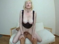 Horny blonde cougar loves taking cock on a sofa