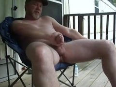 mature dad jerks off outside