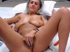 Milf masturbates her shaved pussy on webcam
