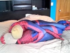 masked spiderman struggles against spiderman