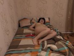 Brunette with a hairy pussy masturbates.HD