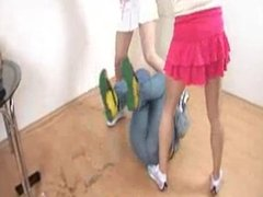 Mistress Michelle and Dark Mistress Trample Slave with Sneakers