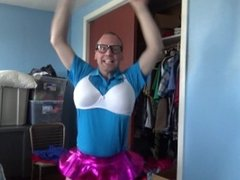 FAGGOT IN BLUE SHIRT, WHITE BRA AND PINK MINI SKIRT