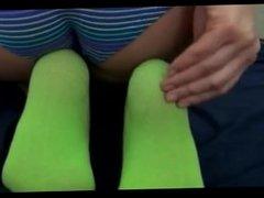 Teen teasing in sexy green socks