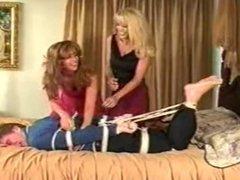 Hogtied Guy Tickled by 2 Women