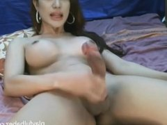 Big dick shemale wanks her cock on web cam