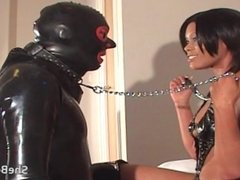 Black mistress makes gimp worship her boots, ass and pussy