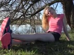 Teen Girl Takes Off Her Shoes And Shows Her Bare Feet