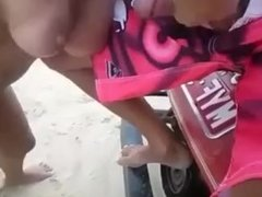 Slut gets spit roasted at the beach