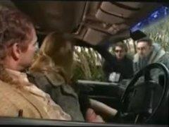 A woman in mnik fur coat give blowjob in a car