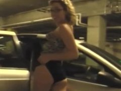 Horny mommy plays in a car park