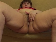 A young fat woman puts a huge candle in her pussy and masturbates.