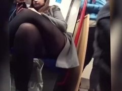 Hidden cam spying under brunette teen's miniskirt while sitted in the metro