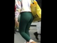 Big ass blonde teen shows us her thong through her tight green leggings !
