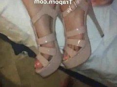 Masturbating her boyfriend with her feet