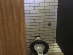 Jerking off in public bathroom with gloryhole!