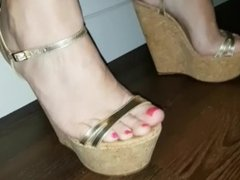 Walking and teasing in sexy gold wedges at home