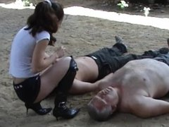 Mistress tramples two slaves in black boots 4