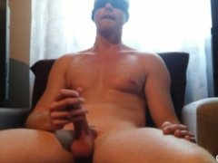 Young sexy guy masturbating and cumming on the armchair