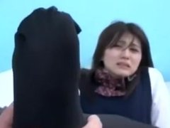 Japanese schoolgirl's feet gets sniffed and licked by a lucky man.