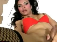 Ladyboy in fishnets shoves beer bottle in ass and jerks cock