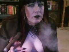Smoking a cigar in my new boobs.