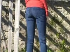 Girl swims in red sweater and jeans