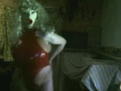 Huge fake Boobs in red rubber Body string