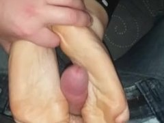 Wife watches TV while I fuck her feet.