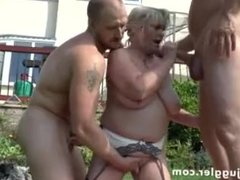 Blonde Milf double dicked in the garden - more at PornWebCamZ.com