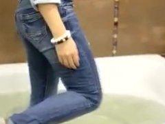 Wetlooker- Nastya in wet blue jeans and converse