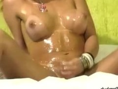 Big butt shebabe oils naked body and swings her cock around