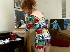 Hot big ass readhead MILF painting in a tight minidress ! enjoy upskirt !