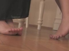2 hotties show feet under table