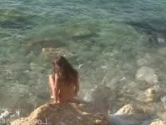 Brunette princess loves being naked on the beach