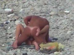 Couple Having Sex At The Beach