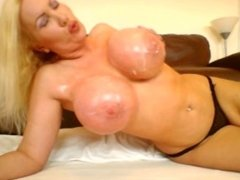 Putting lotion on my new massive 34JJ breasts