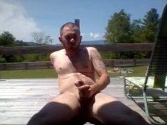 Masturbating in the sun and swallowing cum
