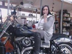 Latina Smoking on a Harley Davidson motorcycle bike