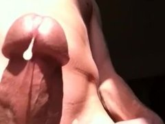 Beautiful shaved cock jerking off and coming in bright sunlight.