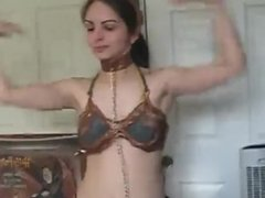 Brunette in Leia costume belly dances