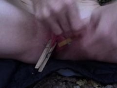 Clothespin pussy torture with lollipop pushed into juicy pussy
