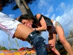 Milf sucks a younger studs big cock outdoors.