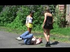 Boots trampling and kicking by 2 young mistress